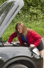 Female motorist with the car bonnet up
