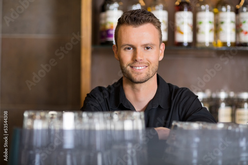 Handsome Male Barista At Coffeeshop