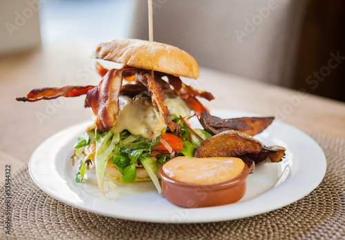 Bacon Burger on Plate in Restaurant