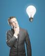 man looking on lamp