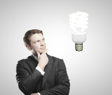 man looking on energy saving lamp
