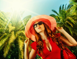 Young beautiful woman on tropical resort