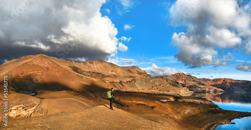 Geothermal landscape with woman on mountain top in Iceland