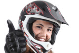 Happy biker woman with a motocross helmet and thumb up