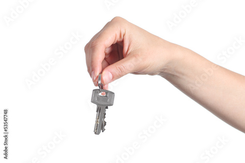 Side view of home keys hanging from a woman hand