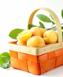 yellow sweet ripe apricots (peaches) with green leaves