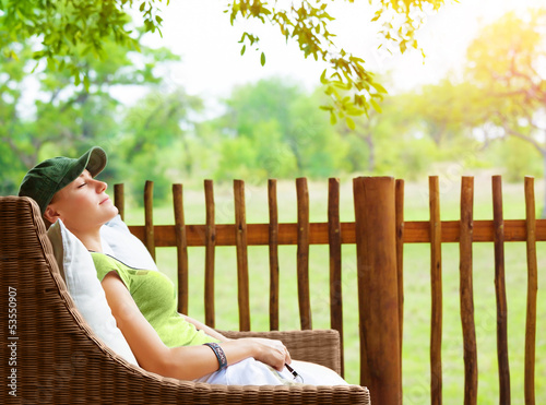 Cute girl resting on veranda
