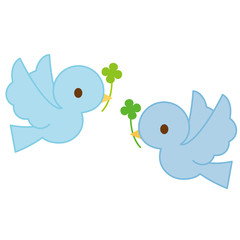 飛ぶ青い鳥 二羽