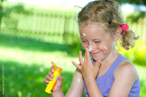 smiling girl with suncream