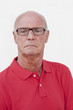 portrait of proud aging man with red shirt