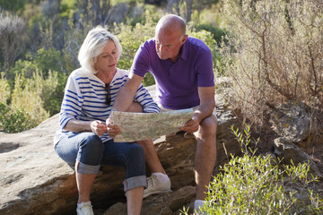 active pensioners searching for new itinerary on map