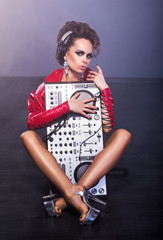 Entertainment. Woman sitting with DJ Mixer