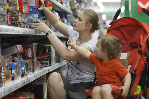 Mother and son shopping for toys