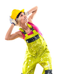 Construction worker in coverall and hardhat posing indoors