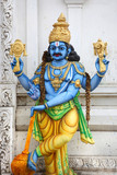 Colorful hindu god lord Vishnu statue on temple