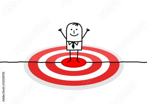 man on big red target