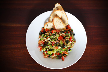 Tabbouleh salad with bulgur wheat, tomatoes, olives and crackers