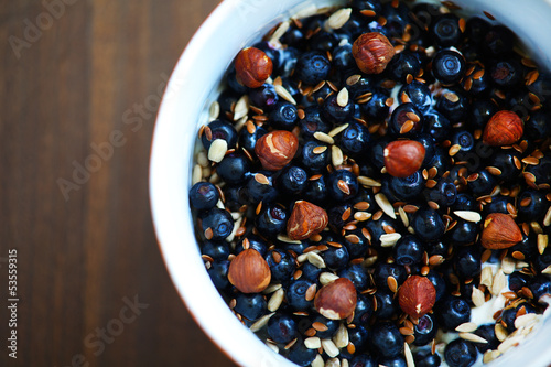 Blueberries, hazelnuts and flax and sunflower seeds breakfast