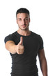 Athletic and attractive young man with thumb up doing OK sign