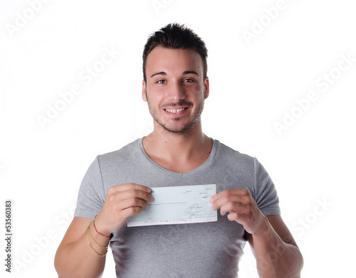 Smiling young man with check in his hands