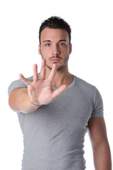 Young man doing stop gesture with his hand