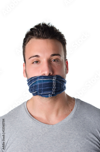 Gagged young man cannot speak