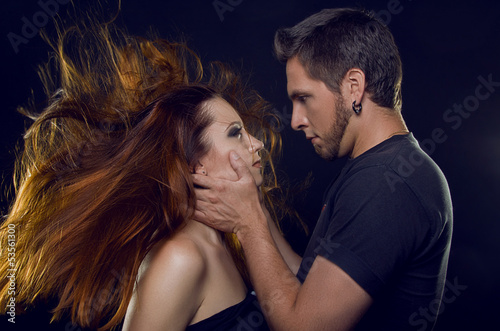 Couple of lovers. Cost profile. The guy holding the girl's face