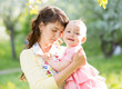 loving mother with baby girl outdoors