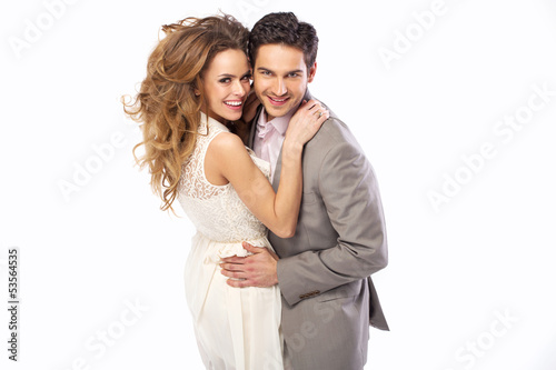 Relaxed and cheerful couple hugging mutually