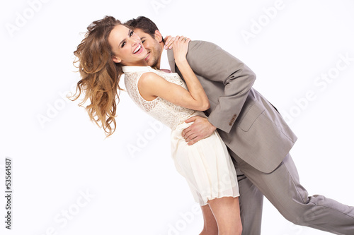 Delighted couple hugging each other