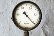 Old manometer on grunge background