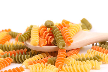 Colorful pasta with wooden spoon.