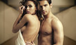 Half-naked couple in romantic pose