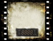 blank old grunge film strip frame with dvd digital clock