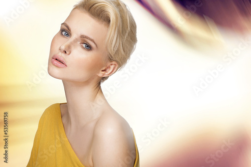 Cute blonde lady with clear complexion