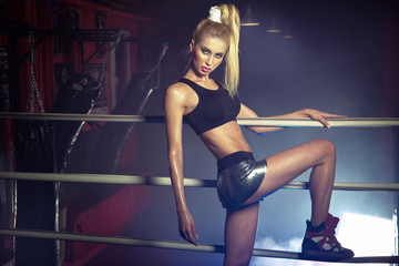 Cute slim woman in the boxing ring