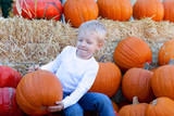child at punpkin patch