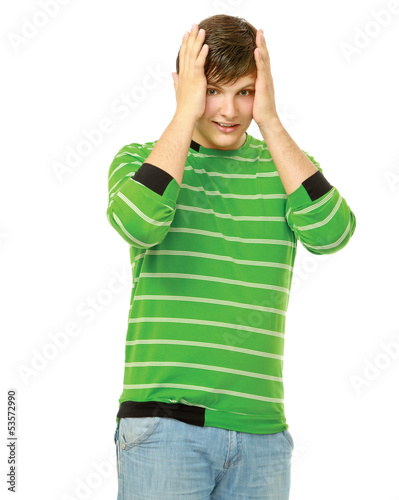 Young man in panic  holding head, isolated on white background