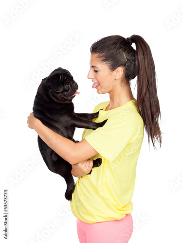 Brunette girl with her pug dog