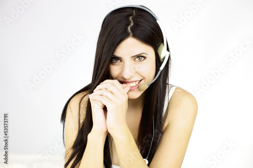 Beautiful woman looking with headset smiling happy