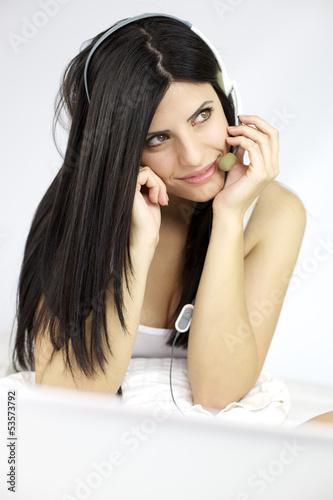 Gorgeous woman thinking while talking on the net with client