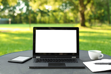 Laptop with blank screen outdoors