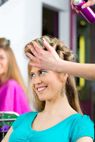 Women at the hairdresser being curled