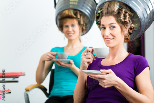 Women at the hairdresser hair being dried