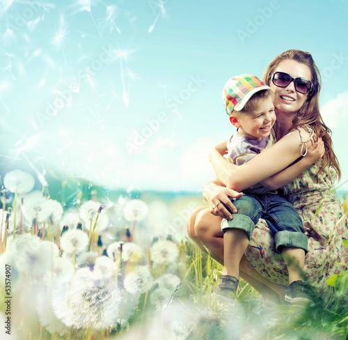 Pretty mom huging her small lovely boy