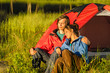 Camping couple enjoying sunset