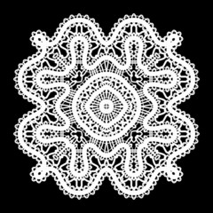 Realistic white lace doily on black