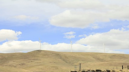 Wind Turbines with Fast Moving White Clouds Timelapse