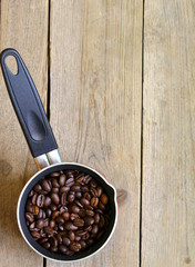 coffee beans and  coffee pot on a wooden table