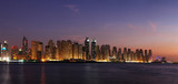 Fototapeta A dusk view of Dubai Marina including JBR from the Arabian Gulf